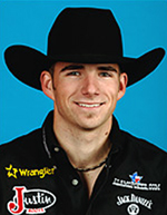 Dustin Elliott of North Platte, Neb., won the opening go-round of the PBR World Finals on Wednesday night in Las Vegas. He'll return to Vegas in December to compete in the Wrangler National Finals Rodeo.