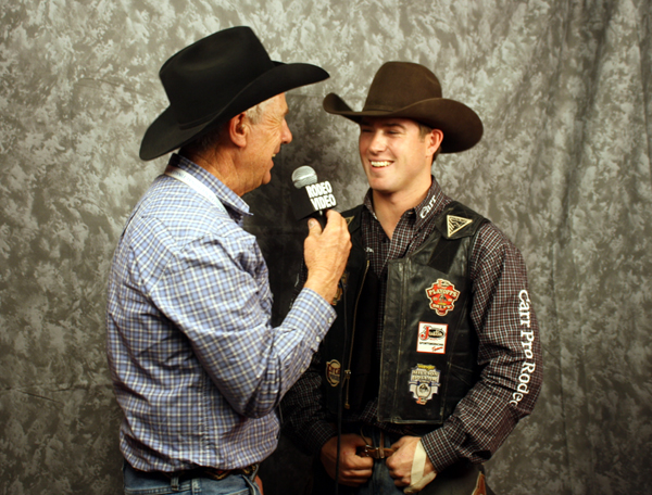 Cort Scheer of Elsmere, Neb., does a video interview on Friday night after winning saddle bronc riding in the ninth go-round of the Wrangler National Finals Rodeo. (PHOTO BY TED HARBIN)
