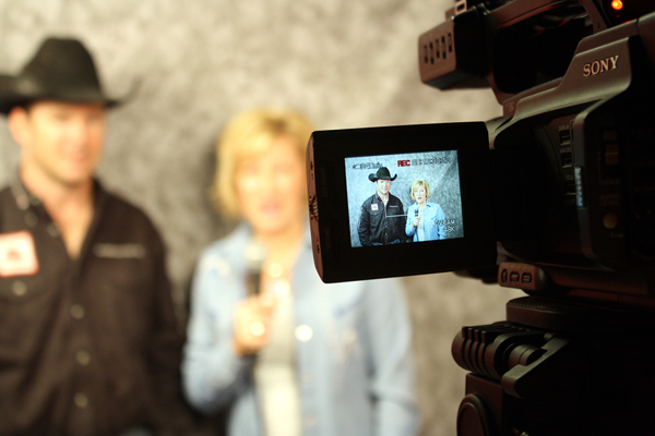 In a view from the viewfinder of a video camera, D.V. Fennell is interviewed by Beyond Rodeo's Susie Dobbs after the eighth round of the Wrangler NFR. (PHOTO BY TED HARBIN)