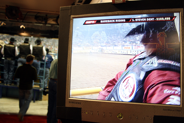Justin McDaniel prepares to ride Andrews Rodeo's Cool Water during the eighth round in a view from the hallway that leads to the arena at the Thomas & Mack Center. (PHOTO BY TED HARBIN)