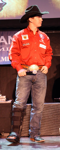 Justin McDaniel stands on stage during the Montana Silversmiths Eighth Round Buckle Presentation at the South Point on Thursday night. By the time the NFR ends Saturday, he hopes to walk away from Las Vegas with the gold buckle given to the world champion. It would be his second in three years. (PHOTO BY TED HARBIN)