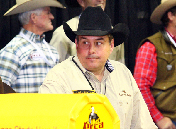 Pete Carr, owner of Carr Pro Rodeo, considers his thoughts a moment before one of his animals bucks at the 2010 Wrangler National Finals Rodeo. Cowboys won nearly $115,000 while riding Carr animals at this year's NFR. (PRCA PRORODEO PHOTO BY KERRI ALLARDYCE)