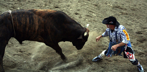 Cory Wall fights a bull during the 2010 Dayton (Iowa) Championship Rodeo. (PHOTO BY TED HARBIN)