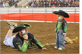 """Radical"" Ryan Rodriguez works a rodeo with his son, Rad Rain Rodriguez."