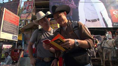 "After making their way to a local tonga stand in Varanasi, India, cowboy brothers Cord, left, and Jet McCoy discover that this ""road block"" will lead them to the meaning of life and their next clue on the April 3 episode of ""The Amazing Race: Unfinished Business."" Photo: CBS ©2011 CBS Broadcasting Inc. All Rights Reserved."