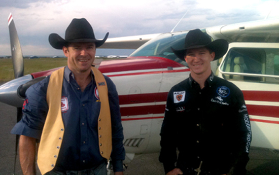 Rodeo bloggers D.V. Fennell, left, and Justin McDaniel prepare to fly from one rodeo to another Sunday, July 3.