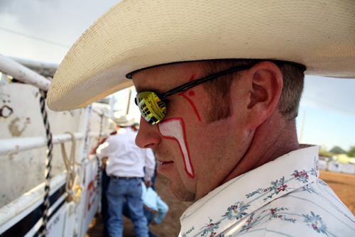 Bullfighter Chris Kirby works on a few things around the chutes as he prepares for the first performance.