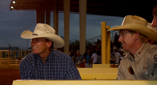 Saddle bronc riders Cody Taton, left, and Taos Muncy share a laugh during Wednesday's performance.
