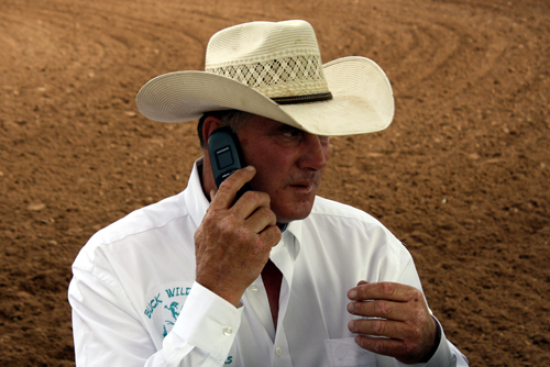 Rodeo chairman Ken Wood gets everything lined out before the start of the first performance in Silverton.
