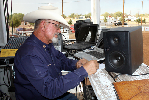 Sound man Lanny Wilson of Guymon, Okla., looks over his notes.