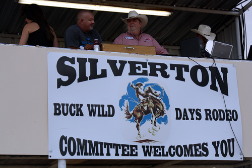 Buck Wild Days Rodeo committee member Rick Beesinger, left, visits with announcer Andy Stewart before the opening night of this year's event Thursday, Aug. 18.