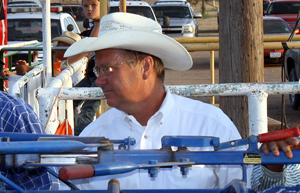 Carr Pro Rodeo chute boss John Gwatney watches the action inside Wood Memorial Arena in Silverton, Texas, during that community's annual rodeo in August 2011. Gwatney and his wife, Sandy, are two key members of the Carr crew and will be instrumental in this year's inaugural PRCA rodeo in Hempstead, Texas.