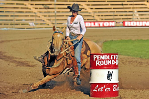 Nikki Steffes and Nilla round a barrel during this year's Pendleton (Ore.) Round-Up. Steffes won the rodeo with a two-run time of 57.02 seconds. (PHOTO FROM THE PENDLETON ROUND-UP)
