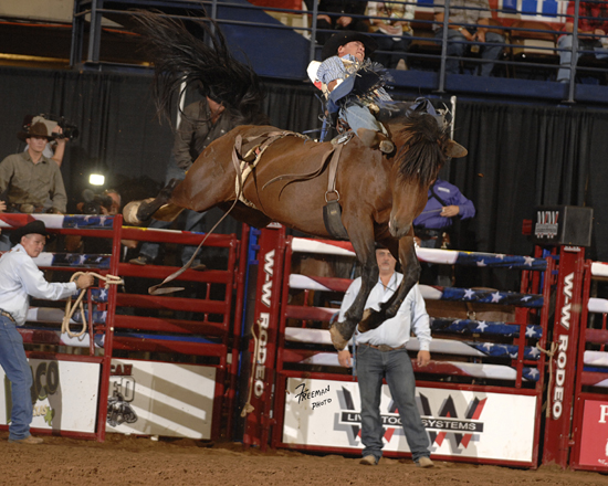 MGM Deuces Night leaps high into the air while matching moves with Chase Erickson during the final round of the All American ProRodeo Finals in Waco this past October. This is just one of the reasons why she's being considered as bareback riding horse of the year. (PHOTO BY ROBBY FREEMAN)