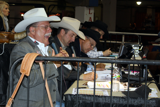 Charlie Throckmorton laughs while announcing the opening night of the Clem McSpadden National Finals Steer Roping at the Fabulous Lazy E Arena.