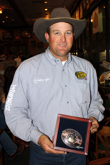 Chance Kelton shows off his Montan Silversmiths Go-Round Buckle, which he earned by winning the third round.
