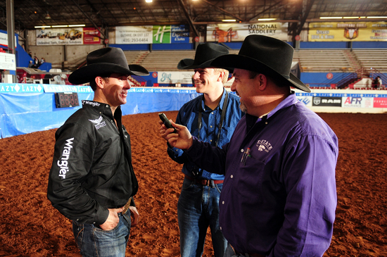 Fifteen-time world champion Trevor Brazile answers questions from Marvin Olberding, center, and me after winning the steer roping world title at the Lazy E Arena near Guthrie, Okla. (JAMES PHIFER PHOTO)