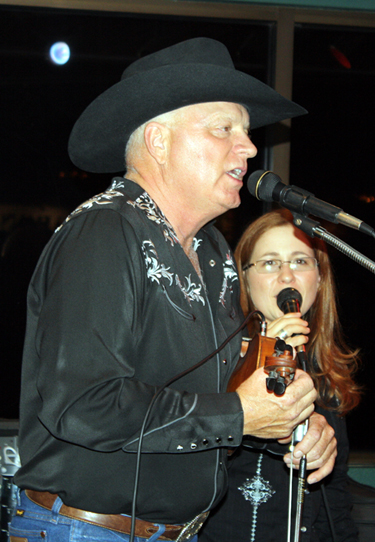 Pake McEntire and Stephanie Ann perform during the opening night after party at Roper's Cantina inside the Lazy E Arena. The duo also performed the national anthem before the Clem McSpadden.
