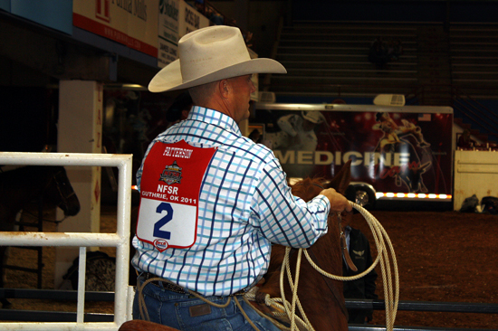 Two-time world champion Rocky Patterson rides into the box to make one of his five runs Friday.