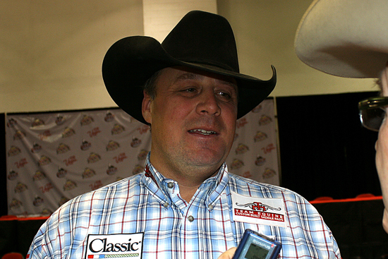 World champion heeler Jhett Johnson of Casper, Wyo., visits with Rick Thompson on Saturday night after clinching his first Montana Silversmiths gold buckle.