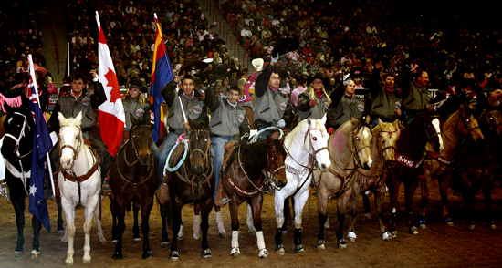 The NFR contestants salute the crowd before the start of Round 5 at the NFR.