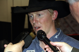 Two-time world champion saddle bronc rider Taos Muncy visits with reporters on Saturday, Dec. 10, after clinching his second Montana Silversmiths gold buckle.