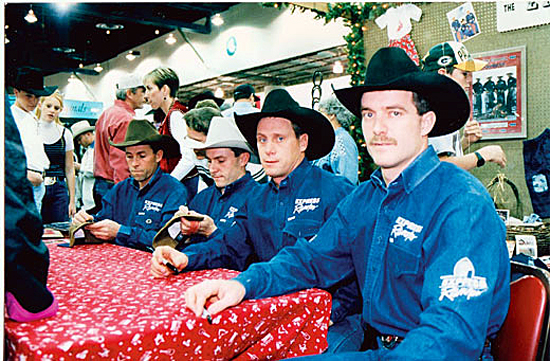 From left, Robert Etbauer, Billy Etbauer, Dan Etbauer and Craig Latham sit together as they sign autographs in this photo taken during their riding days together.