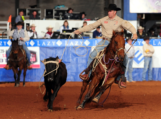 K.C. Jones of Burlington, Wyo., posted the fastest cumulative total on the first day of the Timed Event Championship on Friday at the Lazy E Arena to lead the average. (PHOTO BY JAMES PHIFER)