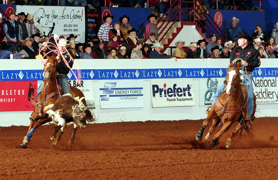 K.C. Jones, right, heads during Saturday afternoon's third round of the Timed Event Championship. He is the leader through 15 runs and the only cowboy with a time of less than 200 seconds, 183.2. (PHOTO BY JAMES PHIFER)