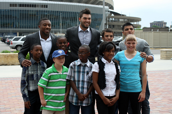 From left to right on the back row, Eric Berry of the Kansas City Chiefs, Eric Hosmer of the Kansas City Royals and professional boxer Victor Ortiz pose with children who are part of the Big Brothers Big Sisters program on Thursday, April 19, at the Truman Sports Complex in Kansas City, Mo.