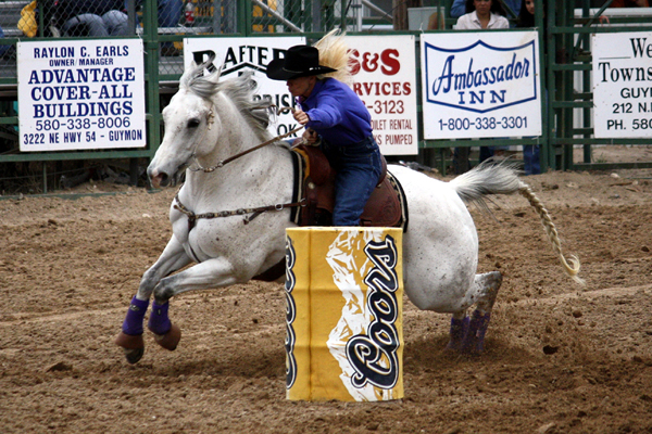 Tana Poppino rides Goose around the third barrel at the 2012 Guymon (Okla.) Pioneer Days Rodeo. Poppino, her husband, Marty, and their son, Brodie, will be part of the field of nearly 500 contestants at next week's Will Rogers Stampede in Claremore, Okla. (LYNETTE HARBIN PHOTO)