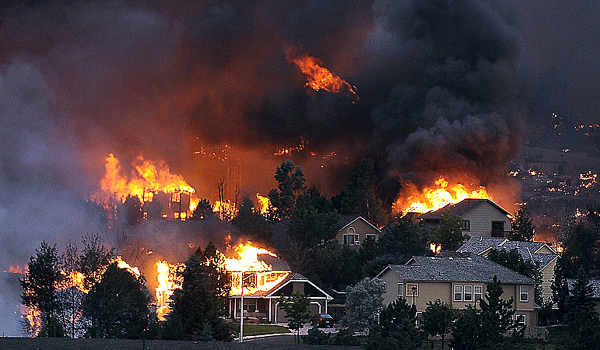 Structures are ignited by the wildfires that rage out of control near Colorado Springs, Colo.