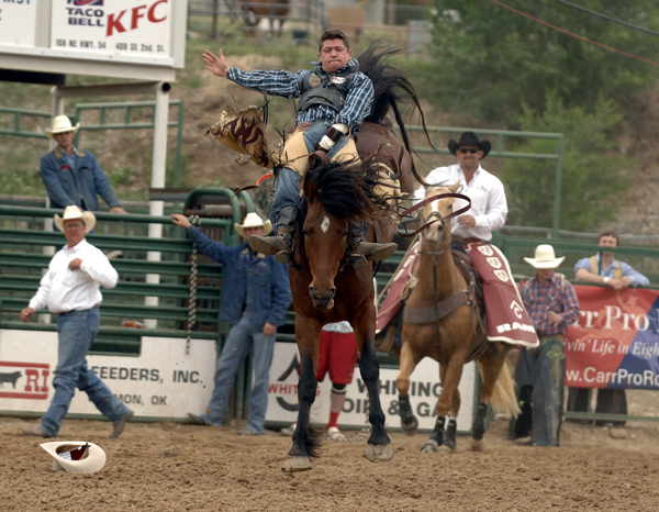 Carr Pro Rodeo's Dirty Jacket matches moves with young gun Tanner Aus during the final performance of the Guymon (Okla.) Pioneer Days Rodeo. Aus made a great ride on the world-class horse but received a no-score for missing his markout on the horse to begin the ride. (ROBBY FREEMAN PHOTO)