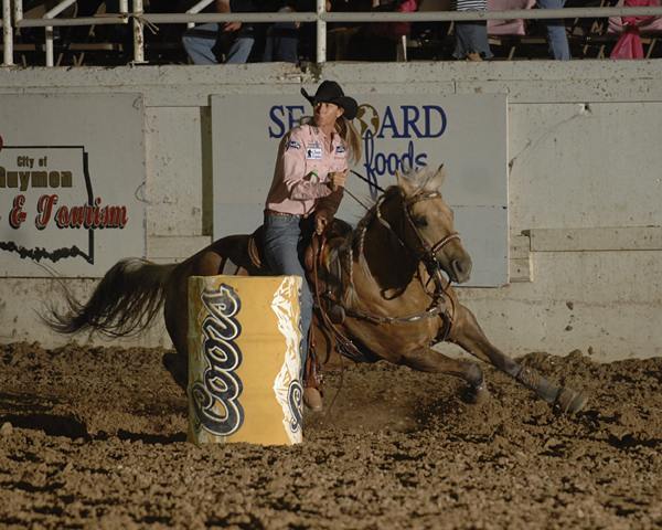Sherry Cervi and Stingray turn the first barrel at the 2012 Guymon (Okla.) Pioneer Days Rodeo en route to winning the average title. (ROBBY FREEMAN PHOTO)