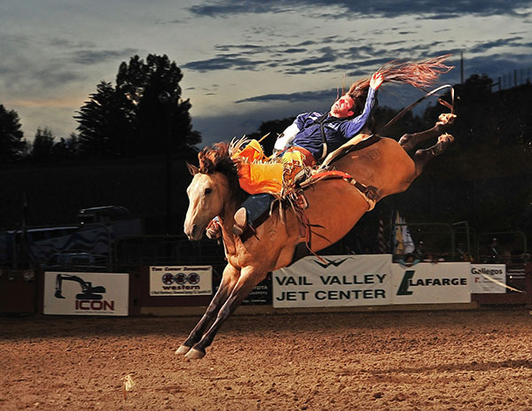 Casey Colletti of Pueblo, Colo., and Carr Pro Rodeo's Grass Dancer perform during the 2011 Eagle County Fair and Rodeo in Eagle, Colo.The two Wrangler National Finals Rodeo athletes will be part of this year's rodeo, set for next week. (PRCA PRORODEO PHOTO BY GREG WESTFALL)