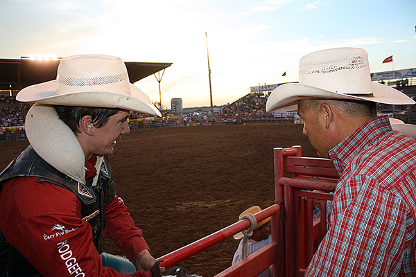 Justin McDaniel, left, the 2008 world champion bareback rider from Porum, Okla., visits with saddle bronc rider Bobby Griswold after McDaniel's ride on Thursday night in Dodge City. Between them, there are eight qualifications to the Wrangler National Finals Rodeo. Each cowboy has been to Vegas four times, and McDaniel owns a gold buckle and two NFR average championships.