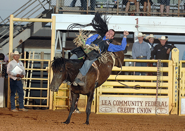 Matt Bright of Azle, Texas, rides Carr Pro Rodeo's Island Girl for 87 points finish in a tie for second place in bareback riding at the Lea County Fair and Rodeo. (ROBBY FREEMAN PHOTO)