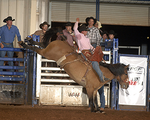 Ryan Bestol rides New Frontier Rodeo's Big Bomber for 83 points to win saddle bronc riding on Friday night. (ROBBY FREEMAN PHOTO)