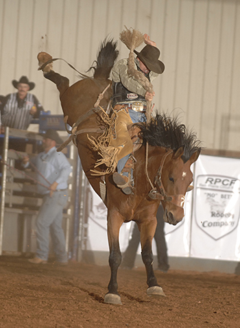 Jesse James Kirby of Dodge City, Kan., rides Mo Betta Rodeo's Shasta for 83 points to win the third round of the Chisholm Trail Ram Prairie Circuit Finals on Saturday night, clinching the circuit's year-end title. (ROBBY FREEMAN PHOTO)