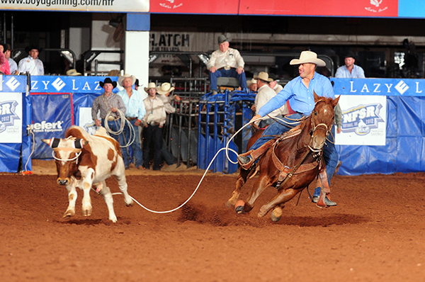Rocky Patterson of Pratt, Kan., ropes his 10th-round steer on Saturday night to clinch his third world championship in four years during the final performance of the 2012 Clem McSpadden National Finals Steer Roping at the Lazy E Arena. He beat Trevor Brazile by $418. (JAMES PHIFER PHOTO)