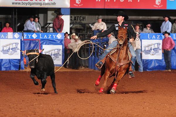 Reigning world champion Trevor Brazile, who owns 16 PRCA gold buckles, placed in three go-rounds Friday night and leads the average in the 10-round, two-day Clem McSpadden National Finals Steer Roping at the Lazy E Arena. There are five rounds to go on Saturday night, but Brazile is the only one of four cowboys in contention for the 2012 world title who has roped and tied down all five steers so far. (JAMES PHIFER PHOTO)