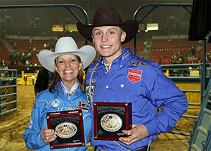 Mary Walker and Tuf Cooper hold their gold buckles after the 10th go-round of the Wrangler National Finals Rodeo in the alleyway that leads out of the Thomas & Mack Center. The Walkers and Cooper shared another set of world titles in 2012, just 31 years after Byron Walker and Roy Cooper did. (PHOTO BORROWED FROM FACEBOOK)