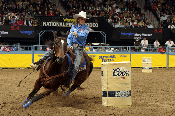 Mary Walker rounds the second barrel during one of her Wrangler National Finals Rodeo runs on Latte – the 2012 AQHA/WPRA Horse of the Year. Walker won her first world title in her first NFR, earning an event best $146,941. (PRORODEO PHOTO BY MIKE COPEMAN)