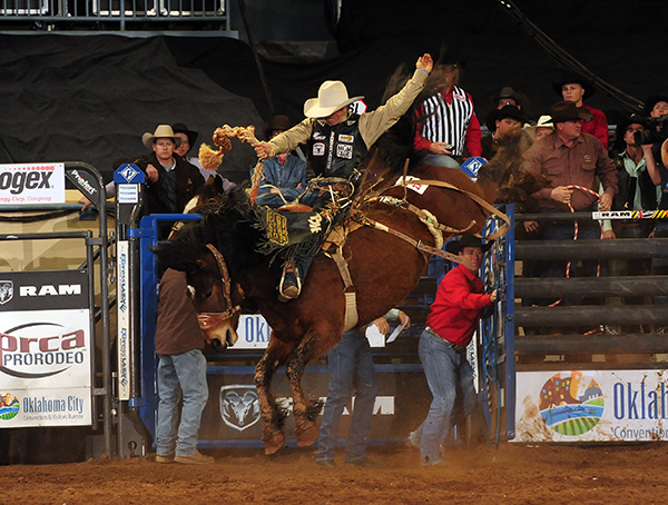 Seven-time NFR qualifier Bradley Harter rides Powder River Rodeo's Lipstick N Whiskey for 86 points to win the first round of the Ram National Circuit Finals Rodeo. (JAMES PHIFER PHOTO)