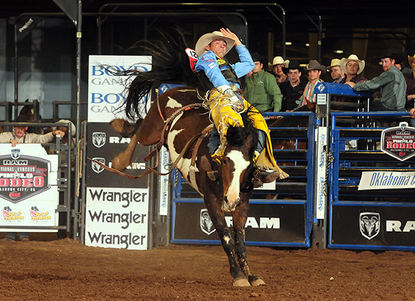 Bobby Mote rides Southwick Rocky Mtn. Rodeo's Hard Times for 87 points to share the final-round victory with Jared Keylon on Saturday night during the Ram National Circuit Finals Rodeo. Mote won his second national championship, earning the title through the tie-breaker system. It was the second time in three years he had done that in Oklahoma City. (JAMES PHIFER PHOTO)