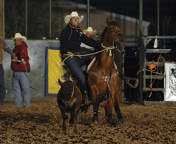 Tie-down roper Cade Swor of Winnie, Texas, roped and tied his calf in 7.9 seconds to take the third-round lead on Friday night at the Guymon Pioneer Days Rodeo at Henry C. Hitch Pioneer Arena. (ROBBY FREEMAN PHOTO)