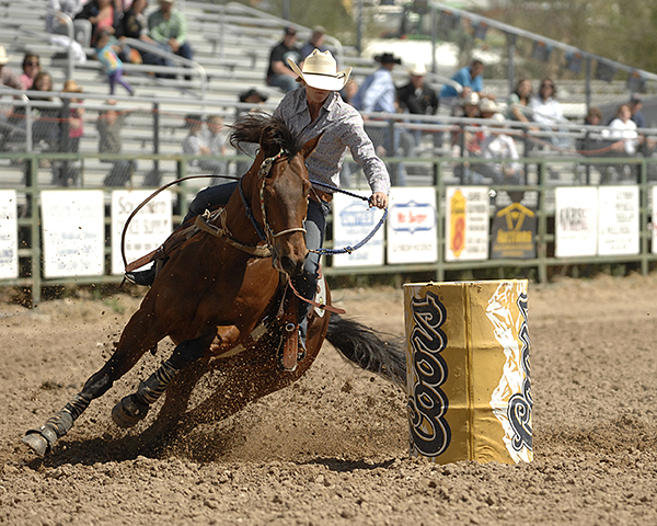 Alicia Stockton of Stephenville, Texas, rounds the second barrel on Saturday afternoon, finishing in a time of 17.46 seconds. After two performances, she leads the barrel racing aggregate with 34.92 seconds. (ROBBY FREEMAN PHOTO)