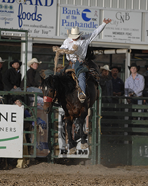 Heith DeMoss rides Pete Carr's Classic Pro Rodeo's Spur Strap for 87 points on Saturday night to take the lead in saddle bronc riding at the Guymon Pioneer Days Rodeo. (ROBBY FREEMAN PHOTO)