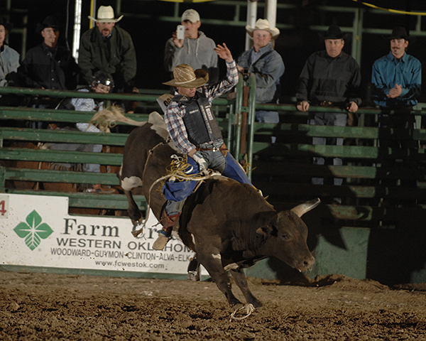 Tyler Smith of Fruita, Colo., rides Carr Pro Rodeo's Rio Bravo for 93 points on Saturday night to take the lead at the Guymon Pioneer Days Rodeo. (ROBBY FREEMAN PHOTO)