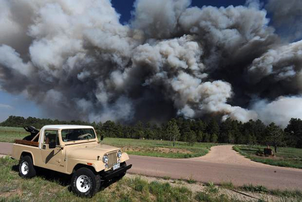A fire burns near Black Forest Road earlier this week. So far, 360 homes have been destroyed and 10,000 acres have been burned. (AP PHOTO)